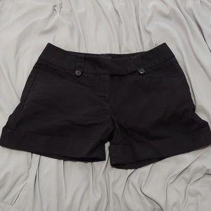 The limited drew fit black cuffed midi shorts